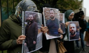 Protesters hold portraits of Zelimkhan Khangoshvili in front of the German embassy in Tbilisi, Georgia, after his death last month.