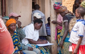 The nurse collects some basic information from villagers waiting outside the screening centre