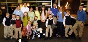 18 of the 19 members of the Duggar family pose for a photo at Northwest Arkansas Regional Airport in 2008.