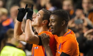 Holland's 19-year-old midfielder Riechedly Bazoer with team-mate Ibrahim Afellay