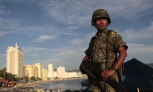 MEXICO-ACAPULCO-CRIME-VIOLENCE-TOURISM-SECURITY<br>A soldier stands guard in a touristic area of Acapulco, in the Mexican state of Guerrero, on October 27, 2015. Acapulco, once known as a celebrities refuge during the 50's, is now the city with the highest homicides rate in the country, where drug trafficking has flourished. AFP PHOTO / PEDRO PARDO (Photo credit should read Pedro PARDO/AFP/Getty Images)