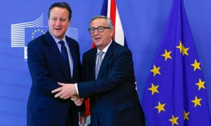 Cameron, left, is greeted by leaders of political groups at the European parliament in Brussels on Tuesday.
