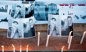 Placards and candles are placed outside St. Peter's Cathedral in Rabat, Morocco in memory of Maren Ueland from Norway and Louisa Vesterager Jespersen from Denmark.