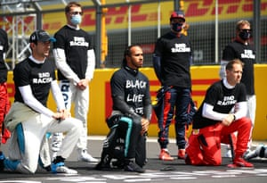 Protest at oppression ... Hamilton takes a knee on the grid in support of Black Lives Matter at Silverstone in August 2020.