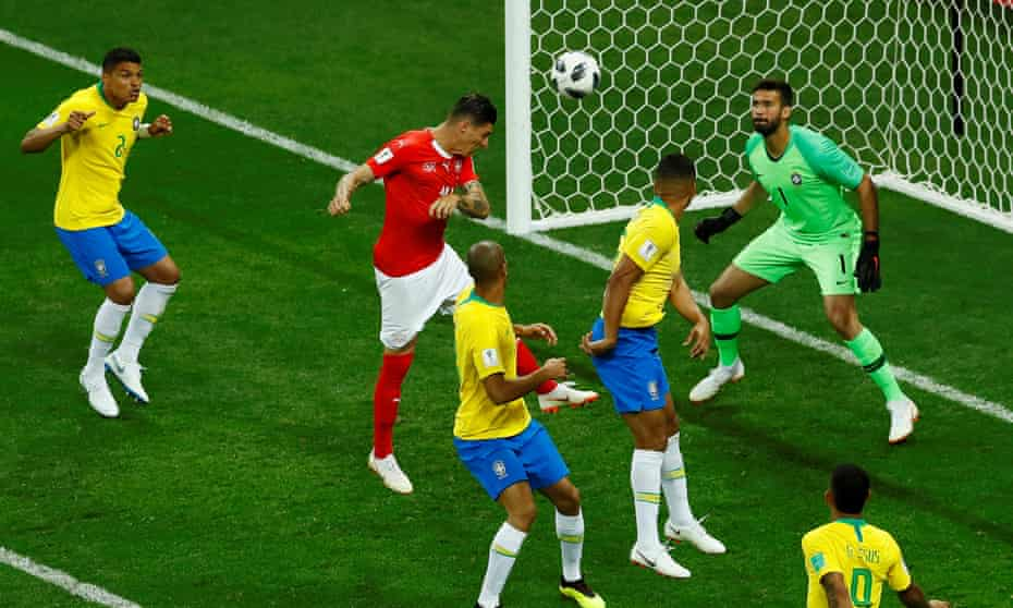 Steven Zuber rises to head in Switzerland's controversial equaliser after Philippe Coutinho had put Brazil ahead with a wonderful curling strike.