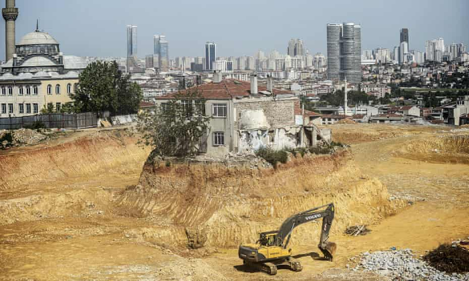 A lone house stands at a construction site in the Fikirtepe district of Istanbul in 2014, as the owner refuses to give his approval for its demolition.