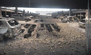 Burned out vehicles and the destroyed floor in the carpark at the Liverpool Echo Arena.