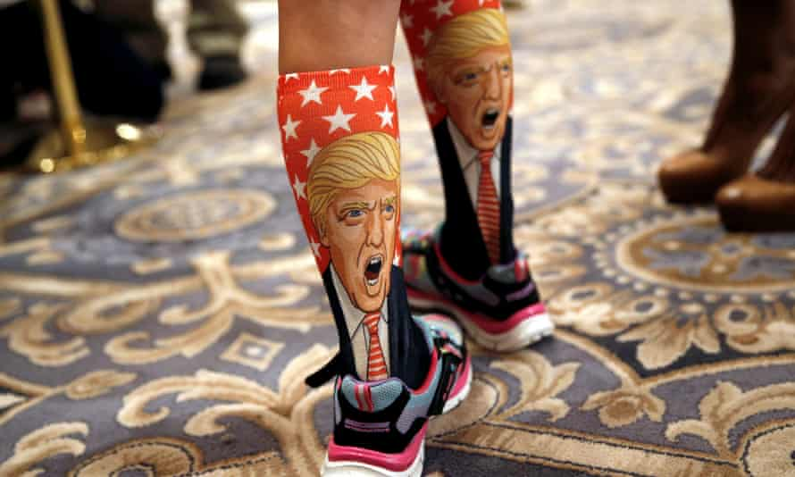 An 11-Year-old girl wears Trump socks at a campaign event for the Republican nominee at the Trump International Hotel in Washington, D.C.