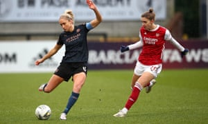 Steph Houghton battles with Vivianne Miedema of Arsenal.