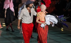 Westwood and Kronthaler walk the runway during the Vivienne Westwood show in Paris on Saturday.