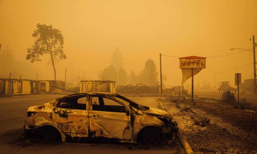 A charred vehicle in the parking lot of the Oak Park Motel, near Gates, Oregon. At least 50 fires have burned over 800 sq miles across the state.