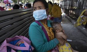Cambodian children wait for medical care in Phnom Penh. The death toll in China from coronavirus has soared overnight to pass 1,300 cases.
