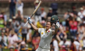Ellyse Perry raises her bat after scoring a century