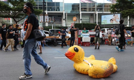 A pro-democracy protester with a somewhat deflated duck