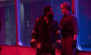 Robert Pattinson, right, and John David Washington in a scene from Christopher Nolan's Tenet.