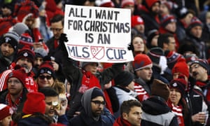 A young Toronto FC fan with a festive banner.