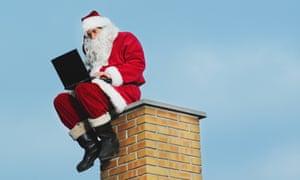 Santa up a Chimney on a laptop