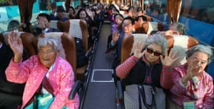 South Koreans chosen to take part in the reunions wave aboard a bus in the city of Sokcho, on South Korea's east coast before they cross the inter-Korean border to reach a resort on Mount Kumgang