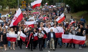 Members of the Polish community march through Harlow