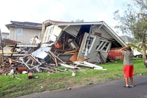 A man looks at the house that collapsed while he was inside during the height of Hurricane Ida in New Orleans