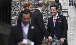 Spencer Matthews (R) talks to Princes William (C) and Harry.