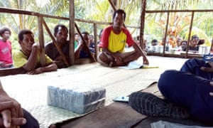 Residents of Budi Budi with part of the cocaine haul