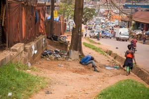 Street children passed out after using drugs in Kisenyi.