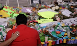 Cesar Rodriguez, friend of Amanda Alvear who was killed in the Orlando shooting, is comforted at a makeshift memorial in Orlando.
