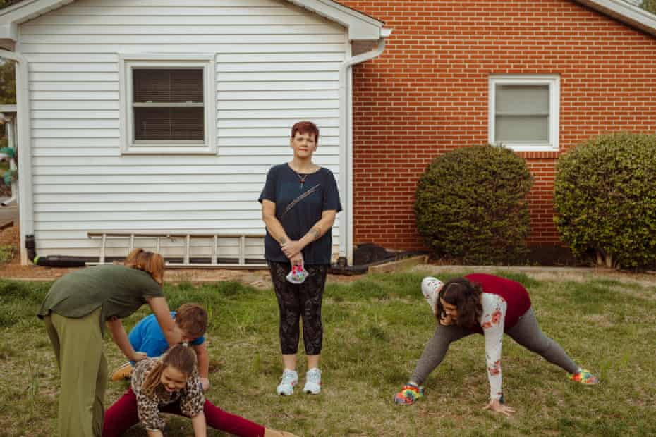 Mary Beth Cochran is surrounded by her grandchildren in Canton, North Carolina.