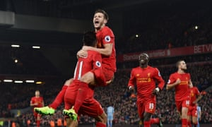 Roberto Firmino is congratulated by Adam Lallana and other team-mates after scoring Liverpool's second goal in their 4-1 win against Stoke City on Tuesday