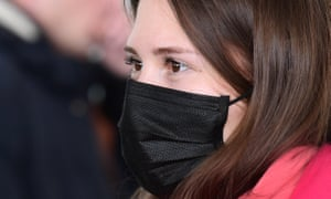 A woman in a face mask arriving at Vladivostok International Airport, Russia, from the Chinese city of Sanya. Russia so far has not confirmed any cases of coronavirus.