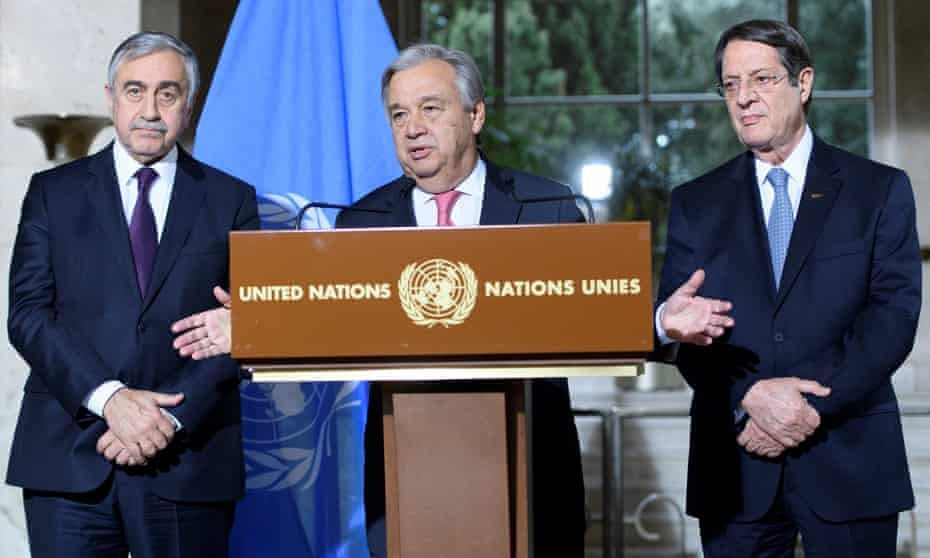 Three men in suits behind a lectern