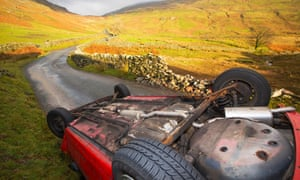 A car overturned on Kirkstone Pass above Ambleside in the Lake District, a victim of Storm Desmond