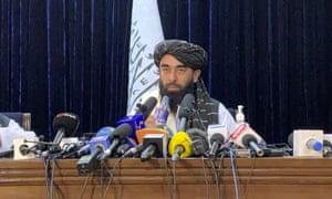 Taliban spokesman Zabihullah Mujahid speaks at at his first news conference in Kabul.