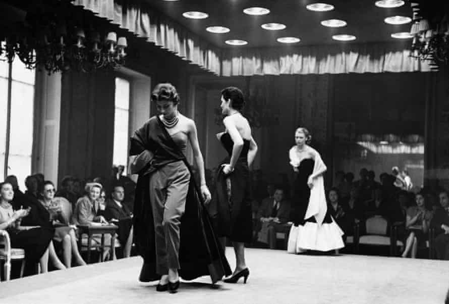 Models parade in evening wear at a fashion show in Florence, Italy, 1951.