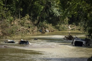 Vehicles are submerged in Trace Creek.