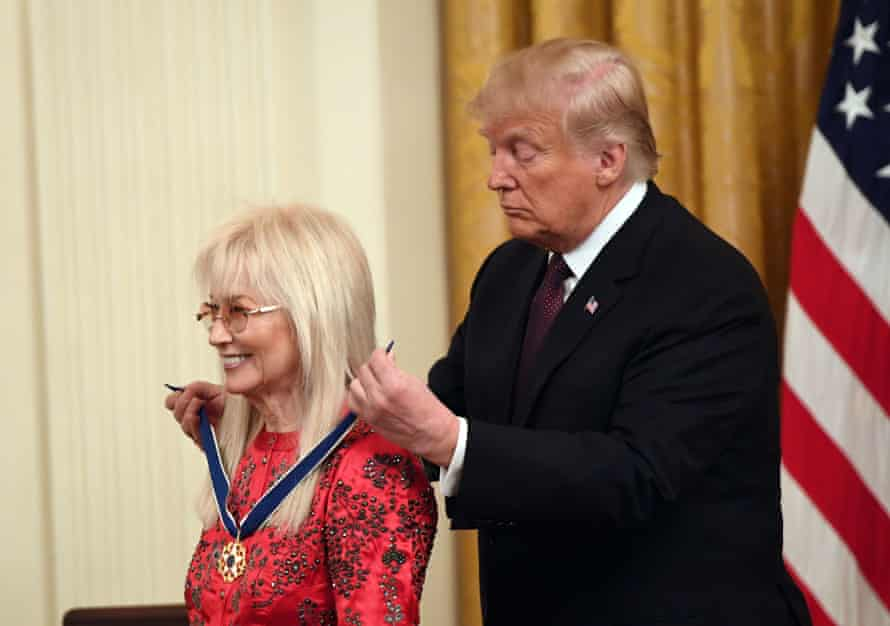 Donald Trump awards the Presidential Medal of Freedom to Miriam Adelson at the White House on 16 November 2018.
