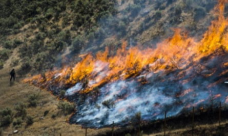 Firefighters control the Tollgate canyon fire as it burns near Wanship, Utah, on 30 July 2018.