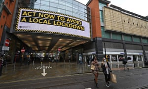 A sign at the Arndale Centre in Manchester warns the public of a local lockdown.