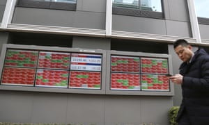 An electronic stock board of a securities firm in Tokyo today