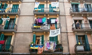 Apartments in Barceloneta display banners protesting against tourist flats.