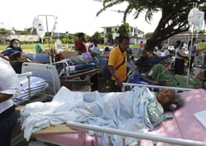 Evacuated patients lie on their hospital beds in the aftermath of a massive earthquake in Juchitan.