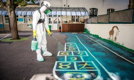 A worker decontaminates a playground from lead pollution in Paris.