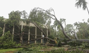 Tropical Cyclone Marcus hit Darwin on Saturday, uprooting trees, damaging houses and buildings, and knocking out power for more than 26,000 people.