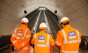 Crossrail staff inspect an escalator in Whitechapel, east London