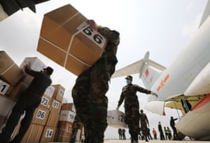 Cambodian soldiers unload medical supplies off a Chinese plane at the Phnom Penh International Airport.