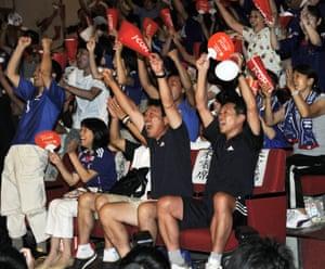 Morihiro (left) and Chinami Kawasumi (second left), parents of Japan's forward Nahomi Kawasumi, are among the supporters celebrating the team's victory at a public viewing at Yamato city, suburban Tokyo.