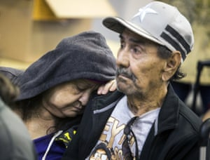 Guadalupe Guerra rests her head on her husband Ray's shoulder as they wait to board a bus to San Antonio from an evacuation centre in Corpus Christi, Texas