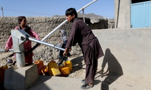 Charahi Qambar residents collecting water from the only hand-pump in the vicinity.