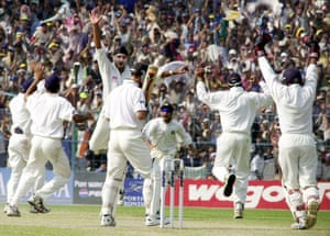 Adam Gilchrist has to go as India players celebrate his dismissal.